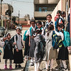 Students waiting their school shift at <br /> main door of the Maimoona school in Islah Zeraay neighbourhood