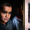 ICLA / Lack of ID / Ayub and his brother Ahmed, both out of school and looking out the window of their house in Hawija