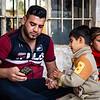 Ahmad and his disabled son, Mithaq - Hawija