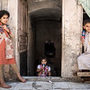 Liqaa's children at the door of the basement they live in - Old city of Mosul