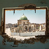 The Mosque of al-Nuri seen through a damaged window - West Mosul