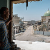 Hussein Abas, watching al Nuri Mosque from his destroyed house in Mosul