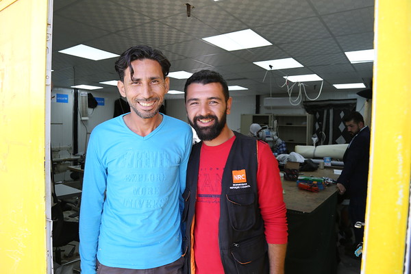 "Caption: Anas with Mohamad, his tailoring teacher, this is where Anas started his training with NRC<br /> When Anas arrived to Azraq camp, he worked as a teacher assistant for a year, he left the job after hearing about the Norwegian Refugee Council's youth centre. ""When I first came to the centre, I immediately asked them if there's a tailoring class, I was lucky enough to know that there are two kind of classes in this centre, tailoring basis and advanced tailoring, since I have a good experience in tailoring, I was signed up with the advanced class."