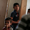 """Mohammad, 13, from Quneitra in Syria poses for a photograph in the kitchen of an NRC rehabilitated shelter in the Bekaa Valley, Lebanon, on July 23, 2014. <br /> <br /> His father Ali fled Syria 5 months ago with his wife and 9 children. He told NRC: """"When things started getting bad in Syria, the company shut down. We left when my wife was 7 months pregnant. I have been trying so hard to find work in Lebanon but I have not succeeded. I am not a carpenter, but I found some work assisting a carpenter. But it dried up after a couple of days. I keep trying. """"<br /> <br /> NRC's rehabilitated shelter programme provides refugees with accommodation by funding owners of partially constructed buildings to complete their properties to a minimum liveable standard. <br /> <br /> NRC/Sam Tarling"""