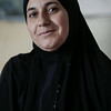 """Souad, 38, from Ghouta near Damascus, stands in a disused store in which her family now live, in the Bekaa Valley, Lebanon, on July 23, 2014. <br /> The family is awaiting placement in an NRC rehabilitated shelter.<br /> <br /> Souad told NRC: """"We left our hometown in Ghouta after our house was bombed. My eldest daughter and my husband were badly injured. Hadeel had to have her toe amputated and she has been badly mentally affected by it. She has become very withdrawn and all she says is that she wants to go back to Syria, to how it was before. I used to be a nurse in Syria."""" <br /> <br /> NRC's rehabilitated shelter programme provides refugees with accommodation by funding owners of partially constructed buildings to complete their properties to a minimum liveable standard. <br /> <br /> NRC/Sam Tarling"""