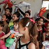 Syrian refugee children rehearse a performance to mark the end of Ramadan at the NRC community centre in Saadnayel, in the Bekaa Valley, Lebanon, on Thursday July 24 2014.<br /> <br /> With Lebanese public schools heavily overwhelmed by the influx of over 1 million refugees since the start of the Syrian crisis in 2011, half of which are children, education programmes such as these provide many young Syrian refugees with education and psycho-social support.<br /> <br /> NRC/Sam Tarling