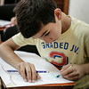 Ghanem, 10, draws a sea-scene during classes at the NRC community centre in Saadnayel, in the Bekaa Valley, Lebanon, on Thursday July 24 2014.<br /> <br /> With Lebanese public schools heavily overwhelmed by the influx of over 1 million refugees since the start of the Syrian crisis in 2011, half of which are children, education programmes such as these provide many young Syrian refugees with education and psycho-social support.<br /> <br /> NRC/ Sam Tarling