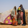 Aigachatou, a single mother and her children, standing in front of their makeshit tent after fleeing violence in Timbuktu. More than a third of those displaced by violence in central and northern Mali are women and children. Credit: NRC