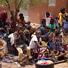 Displaced women and children, sit patiently  in a displacement center in Bandiagara town, mopti. When asked where the men were, it was explained that many men chose to remain in the villages to take care of the animals and property.<br /> <br /> Photo credit: Itunu Kuku/NRC