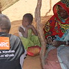 Oumou, 45 years old and his daughter with an NRC staff