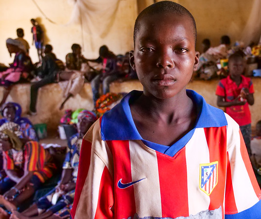 """Ousmane Kene, 12 years old. Fled with his mother Fatoumata Kelipely to Bandiagara. <br /> <br /> """"I saw dead people and i saw others that were injured. I heard gunshots. I was scared and I screamed. Immediately, I went to alert my mother. The only thing I want now is peace. Because, I fled leaving my school and my classmates. I want to go back. """"<br /> <br /> Photo Credit: Itunu Kuku/NRC"""