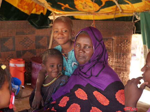 Zatid Dine, poses for the camera with two children. She fled intercommunal violence in Mopti region to come to Tina Djorof in Timbutku region. <br /> <br /> 'We saw such horrors that I will never forget. I am afraid to go back because of what I saw. Some people have even lost their minds. This is how traumatized we are by what we saw. I came here on foot walking for days, others came on the backs of donkeys. When we arrived we received assistance from NRC, but now what we received has run out and we need assistance again especially with food.'<br /> <br /> Photo Credit: Itunu Kuku