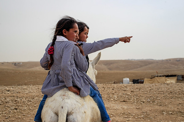 """Children from Al Muntar Bedouin community in the West Bank risk losing their school if the Israeli courts decide to demolish it.<br /> <br /> The Al Muntar school is meant to expand its intake in February 2018 and is a crucial basic service for the community as access the nearest primary school is severely impeded, lacking proper infrastructure.  <br /> <br /> Al Muntar's school headmaster Wisam Merei said: """"If the school is demolished, most of the children will drop out.""""<br /> <br /> A community representative and parent, Abu Hassan, confirmed the concerns: """"They do not have any other place to study inside the community. This school allows our children to study without having to face the risks related to leaving our community and using risky roads close to the nearby settlement.""""   <br /> <br /> Photo: Lys Arango/AAH"""