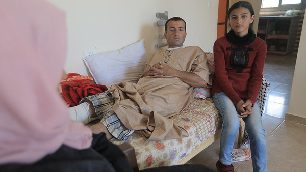 Reham with her  father Tareq Qudaih - he was shot during the 'Great March of Return' in Gaza.