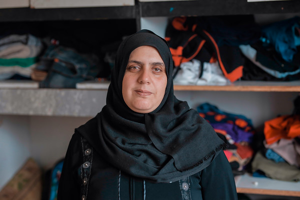"""Umm Muhammad Al Gharbali, Nour's mother.<br /> <br /> """"I had five kids; three boys and two girls. Mahmoud was killed. I now have two boys and two girls: Muhammad, Muhannad, Asma', and Nour.<br /> When Mahmoud was injured, we didn't know that it had happened. He was working that day. He never went to the Great March of Return.<br /> He was at work and it was 14 May. On that day, he went to work and I wasn't at home. I was away from home for four days. I was at Al-Durrra Hospital because Nour was in the intensive care unit. I was with my daughter Nour in the intensive care unit.<br /> On Monday 14 May, I went back home to bring some fresh clothes. They issued a medical transfer for my daughter to go to Israel. Because of my young age, they didn't allow me to travel with my daughter, so her aunt went with her. I went back home to bring some clothes for my daughter Nour and to bring other documents, such as her ID, to prepare her for the medical transfer. <br /> I asked my other daughter if Mahmoud went to work and she told me that he did. I went back to Al-Durra Hospital and I called his manager, Ahmad Yousef. At 3 pm, I was telling him to keep Mahmoud with him and not to let him come back home for now.<br /> He told me that Mahmoud had already gone home.<br /> I called his uncle and told him that Mahmoud had left work at 1 pm and to go look for him. I was afraid his father would punish him for being somewhere away from home. I was very worried about him.<br /> I asked Umm Ahmad about Mahmoud and she said they found him with his friends and that they would bring him home and punish him for being late.<br /> I thanked God that they had found him and he was fine. In reality, they were looking for him everywhere, from hospitals to police stations. They looked everywhere.<br /> Finally, my uncle suggested they go to Al-Quds Hospital. They went there, but they didn't find him.<br /> One of the doctors asked: """"Who are you looking for?""""<br /> They told him they were looking f"""