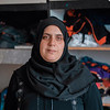 "Umm Muhammad Al Gharbali, Nour's mother.<br /> <br /> ""I had five kids; three boys and two girls. Mahmoud was killed. I now have two boys and two girls: Muhammad, Muhannad, Asma', and Nour.<br /> When Mahmoud was injured, we didn't know that it had happened. He was working that day. He never went to the Great March of Return.<br /> He was at work and it was 14 May. On that day, he went to work and I wasn't at home. I was away from home for four days. I was at Al-Durrra Hospital because Nour was in the intensive care unit. I was with my daughter Nour in the intensive care unit.<br /> On Monday 14 May, I went back home to bring some fresh clothes. They issued a medical transfer for my daughter to go to Israel. Because of my young age, they didn't allow me to travel with my daughter, so her aunt went with her. I went back home to bring some clothes for my daughter Nour and to bring other documents, such as her ID, to prepare her for the medical transfer. <br /> I asked my other daughter if Mahmoud went to work and she told me that he did. I went back to Al-Durra Hospital and I called his manager, Ahmad Yousef. At 3 pm, I was telling him to keep Mahmoud with him and not to let him come back home for now.<br /> He told me that Mahmoud had already gone home.<br /> I called his uncle and told him that Mahmoud had left work at 1 pm and to go look for him. I was afraid his father would punish him for being somewhere away from home. I was very worried about him.<br /> I asked Umm Ahmad about Mahmoud and she said they found him with his friends and that they would bring him home and punish him for being late.<br /> I thanked God that they had found him and he was fine. In reality, they were looking for him everywhere, from hospitals to police stations. They looked everywhere.<br /> Finally, my uncle suggested they go to Al-Quds Hospital. They went there, but they didn't find him.<br /> One of the doctors asked: ""Who are you looking for?""<br /> They told him they were looking for their nephew. He said there was someone there in a coma. Ahmad entered with the doctor. My brother-in-law found out that the boy who was in a coma was my son. My son was injured. His injury was critical. He was injured in the head. My son was in a coma for 51 days.<br /> I called Abu Muhammad again and asked him what happened. I told him that I would accept whatever had happened but that he had to tell me what was going on. I just wanted to know exactly what was going on with Mahmoud. He said, ""I just want to tell you a few words... Your son needs your prayers because he is in a coma. Your son was shot in the head, he has a critical injury. All he needs now are your prayers to God.""<br /> When I arrived, I asked them: ""Is my son dead? If not, let me see him."" They said, ""Ok, You have to be strong.""<br /> I walked in and I was afraid. The doctor held my hand as we walked, and told me to be strong. I was walking with my eyes closed. I was afraid to see my son. The doctor told me, ""Here is your son.""<br /> I opened my eyes. I could not recognise him. I did not find my son,<br /> I found someone else. His head was open and he had shrapnel in his chest. He was living on life support. There were many tubes in his mouth and they wrote, ""Anonymous"" on him.<br /> When I saw him in this condition, I fainted. Because Mahmoud, he was my backbone and sustenance in this life, he was everything to me.<br /> Five days before his injury, his manager knew our financial situation because he is from Al-Gharabli family. He knows that we're struggling a lot. Mahmoud was telling me that Ahmad Yousef wanted to give him extra money on top of his wage as a treat for 'Eid. <br /> He said, ""He wants to give me an extra 100 shekels.""<br /> I told him, ""That's good!""<br /> He said, ""I want to give 50 shekels of it to you because I know you have been struggling. I want to give you 50 shekels to support you<br /> and I don't want anyone to know about it because nobody judges us but God. This is my gift to you."" <br /> I kissed him and I hugged him. Now that I have lost him, I feel I have lost a part of myself. <br /> Nour started having nightmares after her grandmother's death and her brother's injury. Her brother was in hospital for 51 days<br /> and Nour was scared. She started having nightmares more often<br /> and sees Israelis [soldiers] in her dreams. She used to see the family and me killed by the Israelis [soldiers] and being attacked in our home. When she got scared, she would come to me for a hug. I'd wash her face when she was scared and tell her that this was just a dream, not reality. Nothing will happen, this was just a nightmare. I'd pour some water on her face and let her sleep beside me.<br /> The school called me because her studies were slipping. I told them she was having nightmares.<br /> They enrolled her in the ""Better Learning Programme"".<br /> <br /> Photo: Ahmed Mashharawi/NRC"