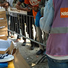 NRC-Praxis staff distributes relief items, including shoes and clothes, to asylum seekers, Belgrade.