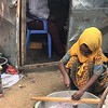 Most of Aden's kids are older than Hani (11) but Hani enjoys waking up early to spend time with her father and help him prepare Samosas. Photo: Abdirisak Ahmed/NRC
