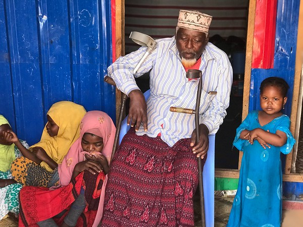 Pictured here are Aden and his children. Though hard to keep up with them, he is happy to live to see them grow. Photo: Abdirisak Ahmed/NRC