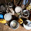 Pots, pans and dishes are on the floor inside a shelter for a displaced Somali family in Baidoa.<br /> Date: February, 2018<br /> Photo: NRC/EU Christian Jepsen