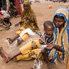 Luley Usane, 28, sits with her young son. She fled her village in Bay region with her family in February 2017 due to drought and conflict in the area. She now lives a camp for displaced families in Baidoa in South Central Somalia. Luley makes a little money to buy food for her family by making rope from nylon bags. The finished ropes are sold for USD 0.8 each at the local market in Baidoa.<br /> Date: February, 2018<br /> Photo: NRC/EU Christian Jepsen