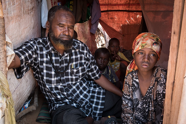 "Abdi Yussuf, 47, lives in a Mogadishu camp for displaced families with his five children. Abdi's wife passed away in January 2017 due to an illness (Abdi is not sure which illness). Shortly after the death of his wife, Abdi and his five children left their home in the Middle Shabelle region in Southern Somalia to seek aid in Mogadishu. Abdi mentions the drought and insecurity as the main reasons for displacement from his region, which has problems with both drought and conflict. Before the displacement, Abdi owned a small shop with basic foodstuff. He also had a few goats, which were used to supplement the income from the shop. When drought hit the area he lost both his business and the goats. <br /> <br /> The failed Gu (long) and Dyre (short) rains of 2017 made the drought situations to progressively develop from mild to severe in all parts of Middle Shabelle region. This forced many families to flee and seek life saving support from the big towns like Mogadishu. Life is difficult. ""Food has become unaffordable for us, so sometimes my family have to go to bed on empty stomachs. This is painful"", Abdi says.<br /> <br /> A few months after arrival to Mogadishu, Abdi's family were among the households selected by NRC to receive cash relief. The programme – funded by the European Union (ECHO) – aims to improve food security among the most vulnerable households affected by drought and conflict.<br /> <br /> The cash transfers through mobile phone enable beneficiaries to quickly get the money without travelling to the town or Hawala shops (a traditional system of transferring money through agents). Abdi has used the money for food, water, school fees and debts which occurred from his late wife's illness and burial.<br /> Date: February, 2018<br /> Photo: NRC/EU Christian Jepsen"