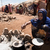 A displaced woman cooks in Baidoa in a camp for families that fled their homes, due to drought and conflict. The majority of the beneficiaries of the cash grant from NRC and EU Humanitarian Aid is used to buy basic foodstuffs such as sorghum, oil, sugar and vegetables. <br /> Date: February, 2018<br /> Photo: NRC/EU Christian Jepsen