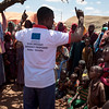 An NRC staff member speaks with displaced people in Baidoa about the donor – the European Union – and the cash programme in Somalia.<br /> Date: February, 2018<br /> Photo: NRC/EU Christian Jepsen
