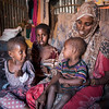 Fatumo Abdullahi, 35, and her family live in a settlement for displaced families in Mogadishu's Kaxda district. Fatumo and her family members were displaced from Bay region due to the drought.<br /> <br /> Before they fled, Fatumo's family lived as farmers, cultivating sorghum and vegetables. But the rain failures crippled the farming activities in the region. When the situation became unbearable, the family sold off their farm at a very low price to pay for the transportation to Mogadishu.  Fatumo's husband is trying to earn an income as a casual labourer in Mogadishu, but often returns to the family with 'empty hands.'<br /> <br /> Fatumo has used the emergency cash disbursement from NRC and EU Humanitarian Aid to purchase food, water, fuel for cooking (firewood) as well as paying for schools fees and outstanding debts. <br /> Date: February, 2018<br /> Photo: NRC/EU Christian Jepsen