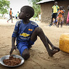 Ayoi Kulo (8) is having lunch at Langbaar primary school. NRC is providing school feeding, a program supported by WFP and UNDP.<br /> Photo: NRC/Tiril Skarstein