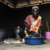 """Nyantihch Deng Manyang is providing food to more than 500 student at Langbaar primary school - a project implemented by NRC and supported by WFP and UNDP.  <br /> <br /> """"My job is important because the food help the children. If children are well fed at school they perform better than if there is no food.""""<br /> <br /> Photo: NRC/Tiril Skarstein"""
