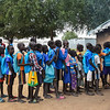 Children queuing for lunch at Langbaar primary school. NRC is providing school feeding at 47 primary schools in Bor, 21 in Twic East and 6 in Duk - a project supported by WFP and UNDP.  <br /> <br /> Photo: NRC/Tiril Skarstein