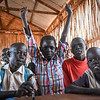 """Kuma (10) has just received his exam results and was 7th in class. That is a great achievement in a class with about 80 students. <br /> """"I was attending classes every day and I was doing my home work. I like going to school. I like writing"""".<br /> """"We came here from Bentiu earlier this year. In Bentiu we had a good life. Here everything is more difficult.""""<br /> """"We had a grass hut, but here we are living in a tent. We used to have a nice bed with mattresses, but here we are only laying on carpets. I slept better back home"""". <br /> """"We came to stay here with a sister who was already here.""""<br /> """"I study hard so that I can be able to support my parents in the future. So I can get an income and make sure we have enough to eat"""". <br /> """"I want to become a doctor, and to work in a hospital and help sick people.""""<br /> """"I want the country to be in peace, so that we can go back to Bentiu.""""<br /> What is peace? """"I do not know"""".  <br /> <br /> NRC's education projects in the protection of civilians sites in Juba are funded by UNICEF. This photo is from Hope primary school in POC3. The school has more than 3000 students from 1st to 8th grade and is running two shifts a day.  <br /> Photo: Norwegian Refugee Council/Tiril Skarstein"""