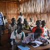 NRC's education project officer Rose Anduwa (to the left) speaking with children at Hope primary school in Juba. <br /> <br /> NRC's education projects in the protection of civilians sites in Juba are funded by UNICEF. This photo is from Hope primary school in POC3. The school has more than 3000 students from 1st to 8th grade and is running two shifts a day.  <br /> Photo: Norwegian Refugee Council/Tiril Skarstein