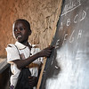 "Emanuel (6) is attending 1st grade at Jejira primary school in Yei, South Sudan. <br /> He fled from Mukaya. <br /> ""My father told me people were fighting. That is why we had to flee. I miss home, but we cannot go back.<br /> I like going to the new school. I want to become a driver – to drive a car.""<br /> <br /> The school is providing education for children displaced by conflict - who have come to Yei for safety. NRC has built the school and is running the education program with support from ECHO. <br /> Photo: NRC/Tiril Skarstein"