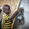 Alfred (4) is in first grade at Jejira primary school in Yei, South Sudan - and is about to learn the alphabet. The school is providing education for children displaced by conflict - who have come to Yei for safety. NRC has built the school and is running the education program with support from ECHO. <br /> Photo: NRC/Tiril Skarstein