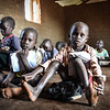 "James (5) fled from Kinda to Yei and is now in first grade at Jejira primary school in Yei, South Sudan. <br /> <br /> ""We came because people were fighting. We had to go by feet. It took us a day to reach here. I was very tired in my legs. <br /> I don´t miss the village. It is okay here, I feel safe and I like going to school here. <br /> I want to become a pilot. I hope that in the future, if I become a pilot, a can fly with people and bring them to other countries."" <br /> <br /> The school is providing education for children displaced by conflict - who have come to Yei for safety. NRC has built the school and is running the education program with support from ECHO. <br /> <br /> Photo: NRC/Tiril Skarstein"