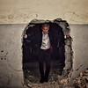 NRC Secretary General Jan Egeland  walks through a big hole between classrooms in a damaged school in Barzeh, outside Damascus.<br /> Photo: Tareq Mnadili/NRC