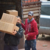 NRC staff offload relief kits from delivery trucks to distribute to families in Hazzeh, Eastern Ghouta. These boxes contain the necessities for everyday use (soap, hygiene items, blankets, mattresses, mats, jerry cans, plastic sheets and a plastic washing basin).<br /> Photo: Tareq Mnadili/NRC