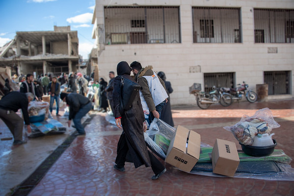 Families living in Eastern Ghouta begin to collect their relief items to help them get through Syria's winter. In recent weeks, heavy rains and plummeting temperatures have increased the need for these basic household items.<br /> Photo: Tareq Mnadili/NRC