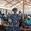 Grace, 27, from Uganda leads a life skills class on sewing machines for both men and women, and for both refugees and the host community, in the Bidibidi Refugee Settlement. (Photo: Charlotte Allan)