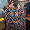 "Uganda. Sarti, 22, from South Sudan holding a skirt she made in a community centre in Zone 3 of the Bidibidi Refugee Settlement. ""I love the community sewing classes. I come every week."" (Photo: Charlotte Allan)"