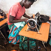 Suzanne, 23, from South Sudan operates a sewing machine in a life skills class in Zone 3 of the Bidibidi Refugee Settlement. (Photo: Charlotte Allan)