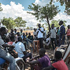 A car mechanics skills class hosted by the NRC with an instructor showing the assembled men (a mix of South Sudanese refugees and local Ugandans) how to fix a carburetor. (Photo: Charlotte Allan)