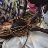 A girl braids a mannequin's hair at a class run by the NRC at the Bidi Bidi refugee settlement. (Photo: Charlotte Allan)