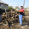 Halyna with her son during firewood distribution