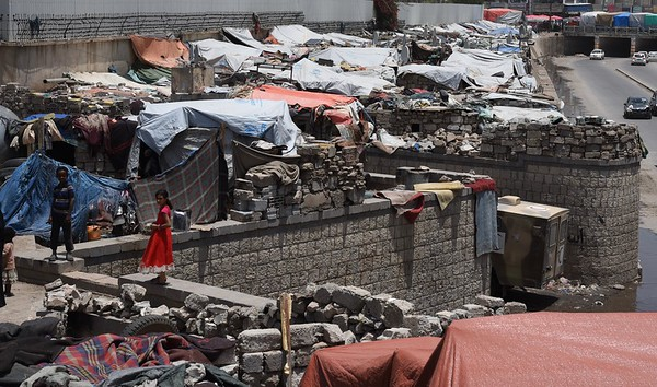 A girl stands inside the Al Habbari informal settlement for displaced people in Sana'a. The settlement is on private land and receives a very small amount of support from its owner. Families living here lack basic services such as showers and latrines. <br /> <br /> Photo: Becky Bakr Abdulla/NRC, 30 August 2018