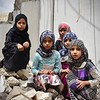 A group of girls sit in the rubbles of the '7th July school' in Amran. The school had only been open for one year when it was hit by airstrikes in 2017. 2.000 children were put out of school as a result. From left: Wijdan (9, black), Athnan (11, pink hijab), Fatima (9, blue hijab in the back), Basma (9, purple dress in front), Fikra (9, blue top). <br /> <br /> <br /> Photo: Suze van Meegen/NRC, 4 September 2018