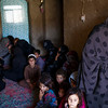Women and children of recently deported families live together in a small compound on the outskirts of Zaranj, Nimroz province. Most of their husbands are drug addicts and live on the streets. (NRC/Jim Huylebroek)