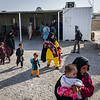 Afghan families deported from Iran leave the DoRR office on the border in Nimroz province. IOM will provide them with shelter for one night before DoRR repatriates them to their home province.  (NRC/Jim Huylebroek)